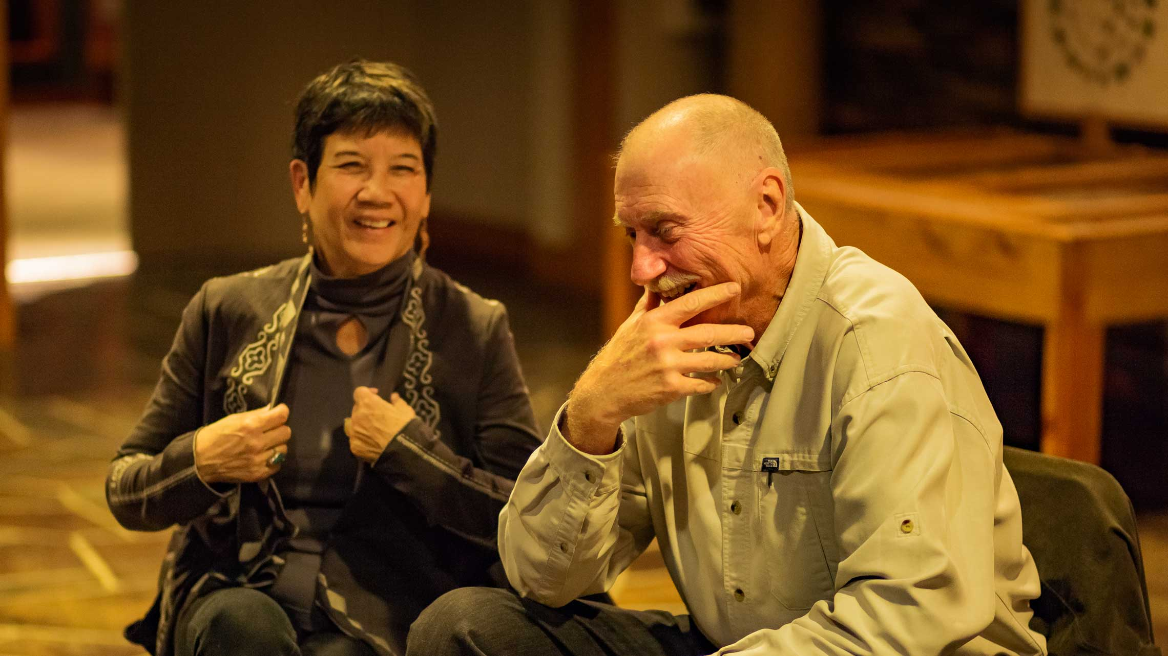 Two people talking at an Oregon Humanities program in Bend in 2016