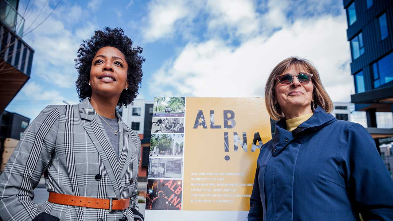 Rukaiyah Adams and Zari Santner stand in an area of the former city of Albina that they hope to revive.