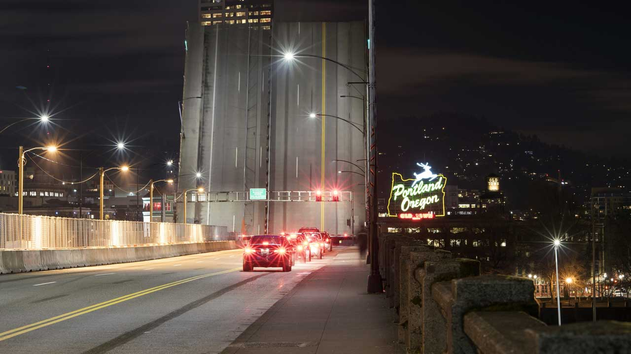 A photo of downtown Portland taken from the Burnside Bridge. The bridge is raised, obscuring the view.
