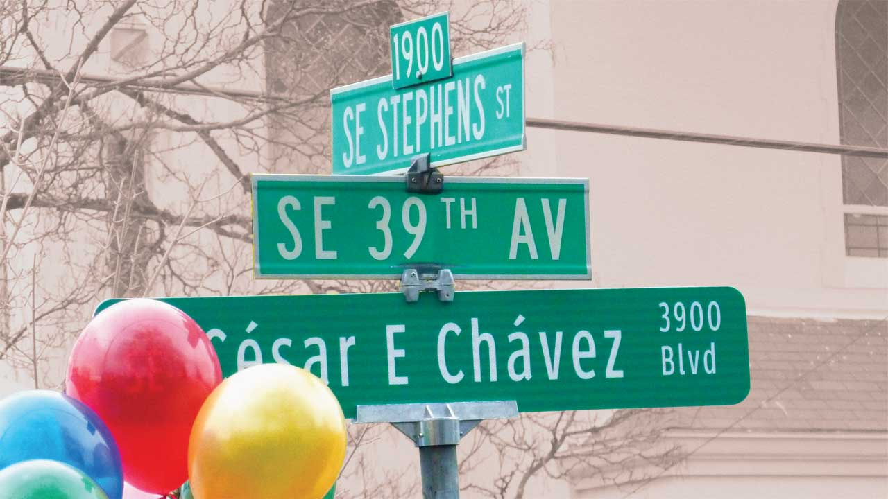 A street sign at the intersection of SE Stephens St. and SE César E Chávez Blvd., at the unveiling of the latter street's name change from SE 39th Ave. There are balloons in the foreground.
