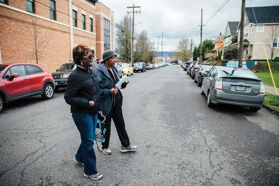 Bennie Hill and Thelma Diggs (in hat)  walk through North Portland on a tour set up by the SHARP program.